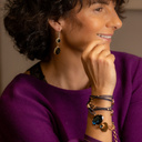 Casual chic. Leather bracelet with charms